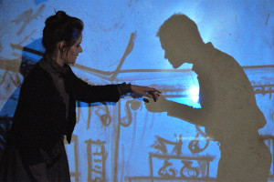 """Nicole Fabbri (left) and Mark Souza (silhouette) perform """"Cool Air"""" in LOVECRAFT: NIGHTMARE SUITE. (photo credit: Jeremy Andorfer)"""