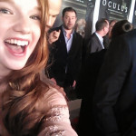 Annalise Basso sneaks Oculus costar Rory Cochrane into her red carpet selfie.