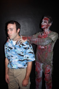 "Mac (Tyler Koster) and one of the residents in ""Attack of the Rotting Corpses."""